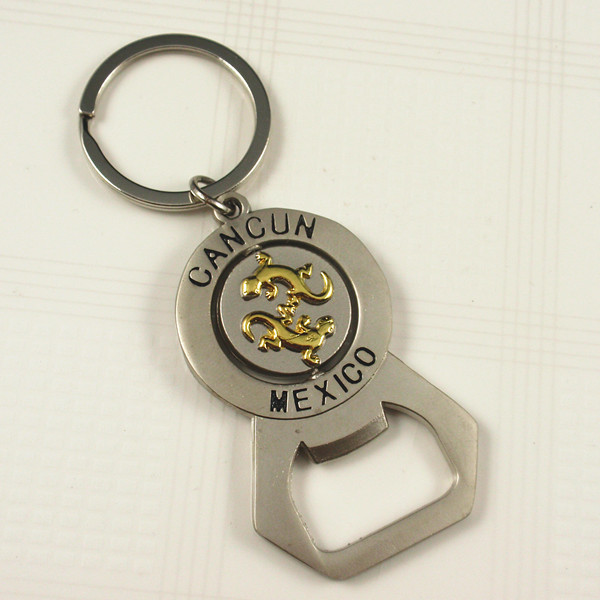 Rotating bottle opener keychain with Mexico logo